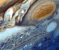 The planet Jupiter's Great Red Spot is a huge mass of swirling gas. At its widest, it is about three times the diameter of the Earth.
