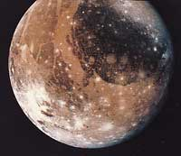 Ganymede, a moon of Jupiter, has craters and cracks on its surface. Asteroids and comets that hit Ganymede made the craters. The cracks are due to expansion and contraction of the surface.