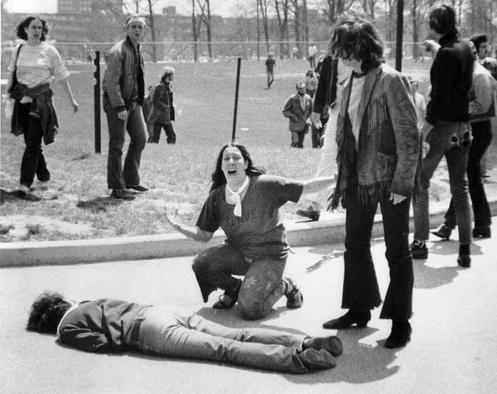 This Pulitzer Prize winning photo by John Filo shows Mary Ann Vecchio screaming as she kneels over the body of student Jeffrey Miller at Kent State University on May 4, 1970. National Guardsmen had fired in to a crowd of demonstrators, killing four and wounding nine.