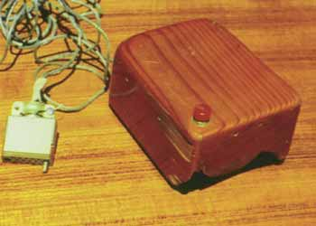 The first mouse was a simple hollowed-out wooden block, with a single push button on top