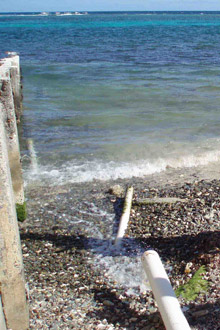 Runoff from this pipe in the U.S. Virgin Islands spews directly into the ocean only a few hundred yards from reefs. Photo courtesy of the NOAA Coastal Programs Division