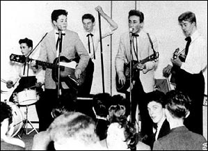 Paul McCartney, aged 15, performs with The Quarry Men, led by John Lennon