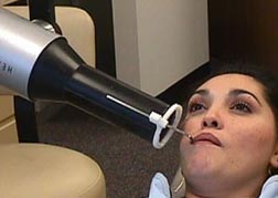 Woman in dentist's chair.