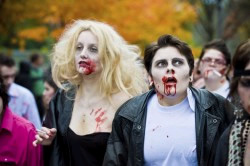 Photo: A couple dressed as zombies - Danny Zucco and Sandy Olsson from the movie Grease walking in the annual Toronto Zombie Walk.