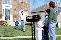 Photo: Family members meeting by their mailbox. You should pick two meeting places, one close to your home and one farther away.
